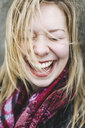 Portrait of woman with eyes closed laughing - ISF09467