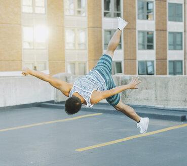 Man breakdancing on concrete floor, Boston, Massachusetts, USA - ISF09572