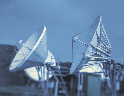 Satellite dish receivers against cloudy sky - CUF25729