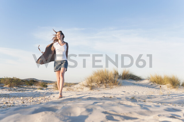 Woman walking on beach - CUF26000