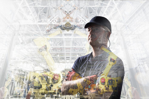 Conceptual image of factory worker in car factory - CUF26273
