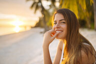 Portrait of young woman on Anda beach at sunset, Bohol Province, Philippines - CUF26516