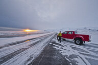 Man with off road vehicle parked on highway 1, Skaftafell, South East Iceland - CUF26744