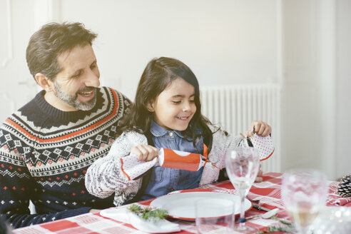 Girl with Christmas cracker at family Christmas party - CUF27056
