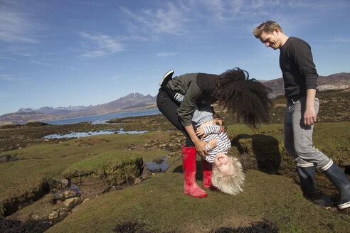 Mother tickling son, Loch Eishort, Isle of Skye, Hebrides, Scotland - CUF27298