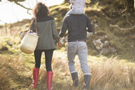 Mid adult couple on walk holding hands - CUF27337