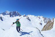 Mature male skier on ridge at Mont Blanc massif, Graian Alps, France - CUF27418