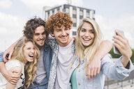 Friends taking selfie outdoors - CUF27872