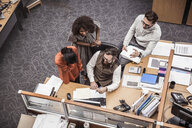 Overhead view of business team meeting at office desk - CUF27905