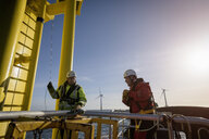 Engineers about to climb wind turbine on offshore wind farm - CUF28093