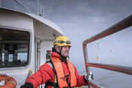 Portrait of engineer on boat at offshore windfarm - CUF28189