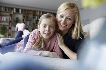 Mother and daughter having fun at home - RBF06274