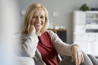Happy woman relaxing at home - RBF06289