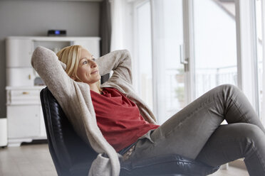 Happy woman relaxing at home - RBF06295