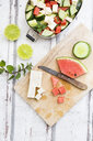 Lunch box, preparation of watermelon salad with feta, cucumber, ment and lime dressing - LVF07069