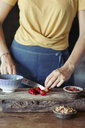 Woman preparing cutting strawberries on cutting board - ALBF00340