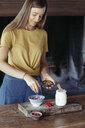Woman preparing muesli - ALBF00349