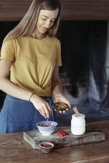 Woman preparing muesli - ALBF00349