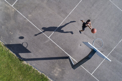 Aerial view of young man playing basketball - STSF01609