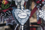 Close up of heart shaped xmas decorations on German Christmas market stall - CUF28314