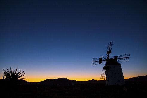Silhouette of Molino de el Roque at dawn, Fuerteventura, Spain - CUF28392