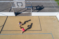 Young women playing basketball, aerial view - STSF01617