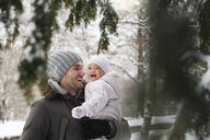 Portrait of happy father with laughing baby girl in winter - DIGF04569