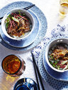 Bowls of curry with steamed rice and Japanese umeboshi vinegar - CUF28442