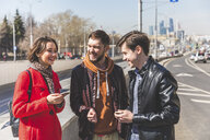 Russia, Moscow, group of friends talking next to a road - WPEF00398