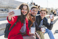 Russia, Moscow, group of friends taking a selfie and showing their cups of coffee - WPEF00410