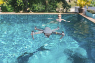 Flying drone over the swimming pool - MOMF00445