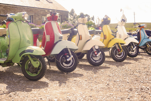 Colourful scooters parked in a row - CUF28840