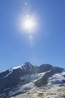 Austria, Carinthia, Grossglockner peak, galcier against the sun, High Tauern National Park - GWF05540