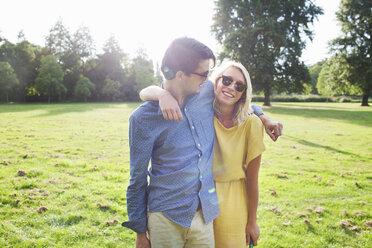 Portrait of romantic young couple in sunlit park - CUF30049