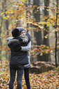 Girls hugging in autumn forest - CUF30516