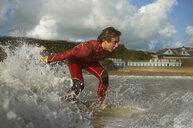 Teenage boy, surfing - CUF30654