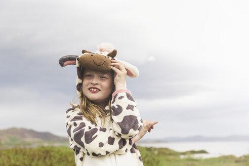 Girl wearing animal onesie with arms folded, Thingvellir, Iceland - CUF31179