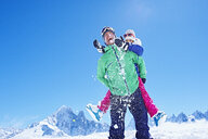Father giving daughter piggyback ride, Chamonix, France - CUF31260
