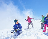 Family having snowball fight, Chamonix, France - CUF31266