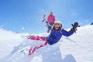 Girl falling into snow, Chamonix, France - CUF31272