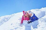 Mother and daughter playing in snow, Chamonix, France - CUF31290