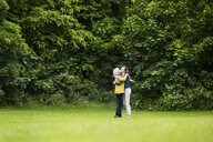 Senior woman and daughter hugging in park - CUF31335