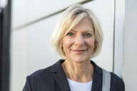Portrait of confident senior businesswoman outdoors - FMKF05141