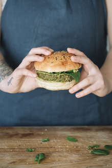 Woman holding homemade vegan burger - ALBF00396