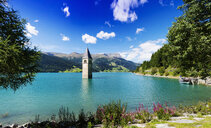 Church spire in turquoise lake, Trentino Alto Adige, Italy - CUF31358