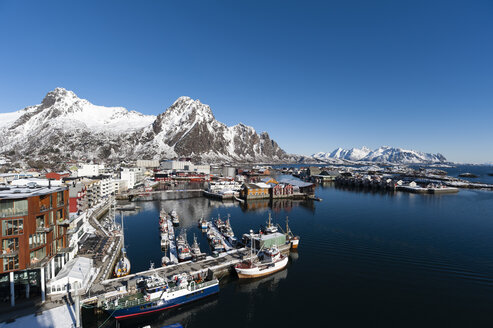 Elevated view of harbour and snow capped mountains, Svolvaer, Lofoten Islands, Norway - CUF31382