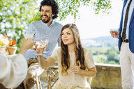 Group of friends drinking champagne, making toast, outdoors - CUF31475