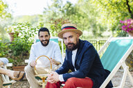Two of male friends, relaxing outdoors - CUF31478