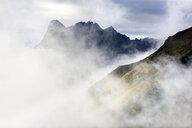 USA, Alaska, Wrangell-St. Elias National Park, mountains in fog - CVF00836