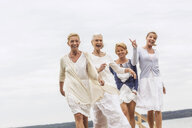 Group of female friends, walking outdoors, laughing - CUF31629